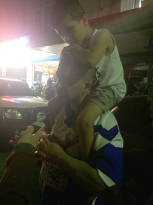 Sam from Greenacre celebrates the victory with his son